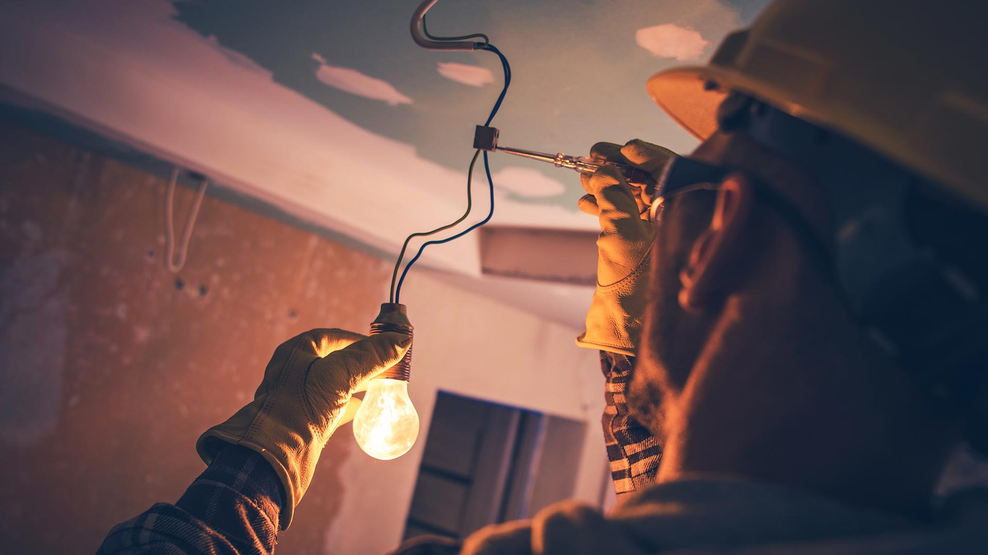 Residential electrician working at True Builders.