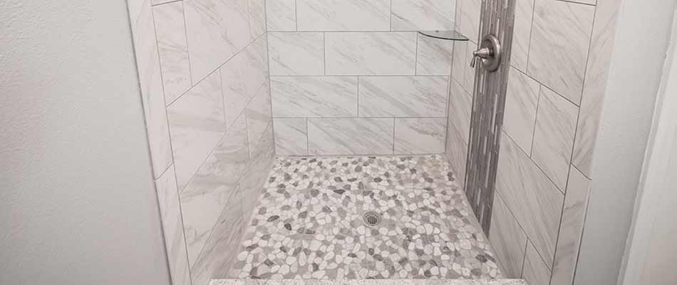 Shower with mosaic tiles as a focal point for this bathroom remodel done in Wesley Chapel, FL