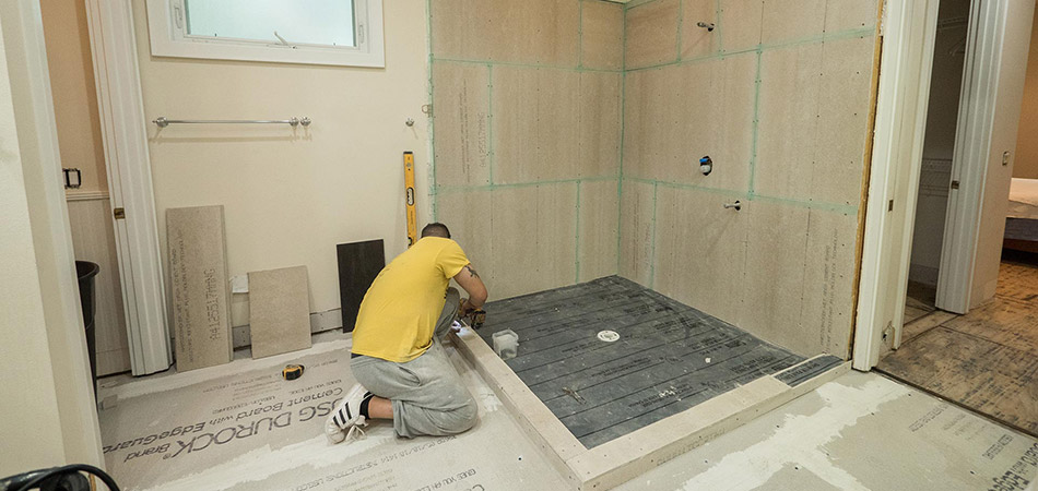 One of our experienced team members starting a bathroom  remodeling project in Lakeland.