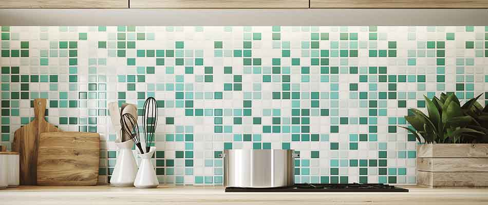 Green and white tiled backsplash that is in the kitchen of a Lakeland home.