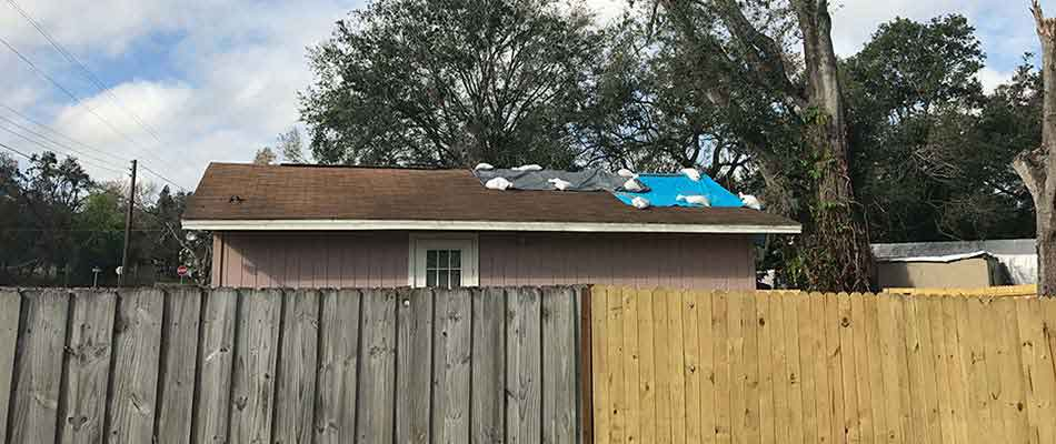 A home in Plant City that has missing shingles from a powerful storm, and is now dealing with roof leaks.