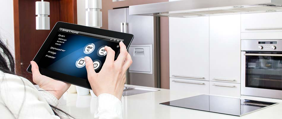 This homeowner in Winter Haven is controlling smart kitchen appliances from a tablet.