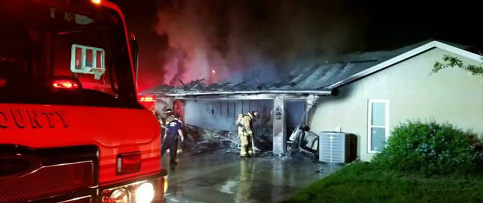 Fire department extinguishing home fire in Lakeland, FL.