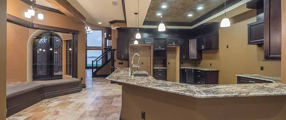 Open kitchen concept with custom dark wood kitchen cabinets in Winter Haven, FL.
