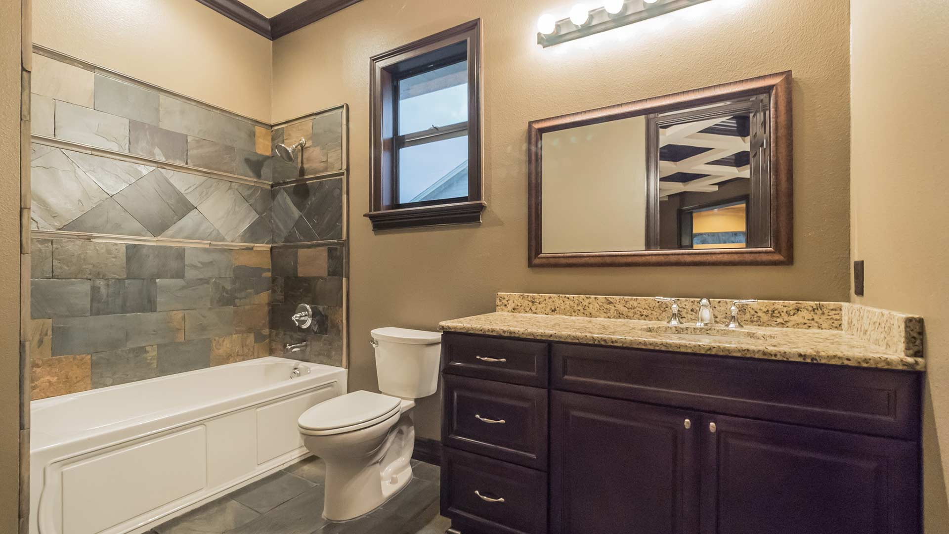 Example of a restored and remodeled bathroom by True Builders for a homeowner in Plant City.